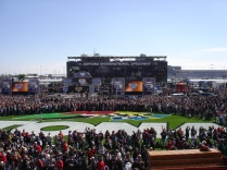 The crowd of people who purchased track passes in addition to their race tickets.
