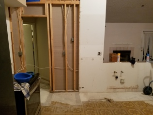 The pantry backed up to a small linen closet. Now you can see straight through to the guest room.